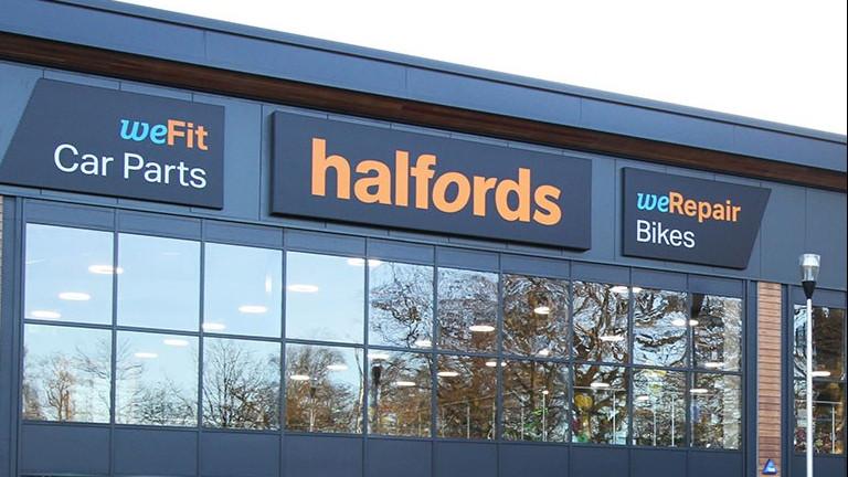 Halfords warns on second half profits